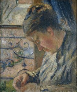 Madame Pissarro Sewing beside a Window, by Camille Pissarro