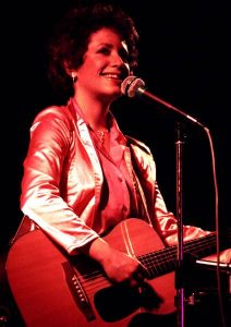 Janis Ian with guitar in cocert, Dublin. Photographer: Eddie Mallin